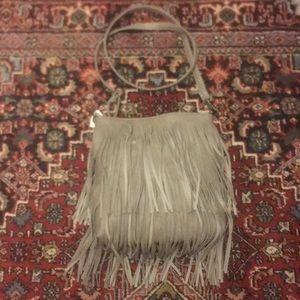 Handbags - NWT Gray cross body bag w/fringe… Top zipper